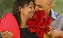 African American man giving Valentine's Day gifts to wife