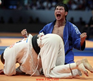 Tsagaanbaatar Hashbaatar of Mongolia celebrates after winning his match against Alim Gadanov of Russia in the under 66 kg men's semifinals_