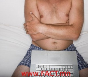 man in his underwear using a laptop on the couch