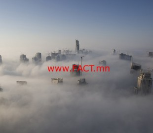 Heavy fog rolls by early in the morning near the Dubai Marina