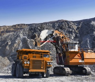 Loading the gold ore into heavy dump truck at the opencast mining