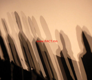 Shadows of members of a panel are seen on a wall before a meeting about the
