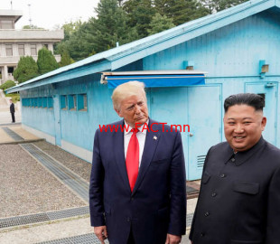FILE PHOTO: Trump meets with North Korean leader Kim Jong Un at the DMZ on the border of North and South Korea